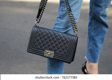 1caa269f3e MILAN - SEPTEMBER 22  Woman with black leather Chanel bag before Giorgio  Armani fashion show