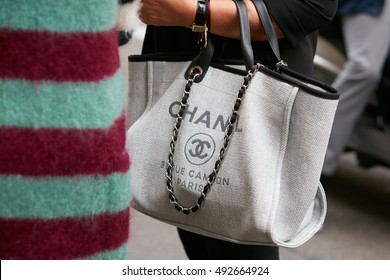 68e1f569c986 MILAN - SEPTEMBER 22  Woman with Chanel canvas bag before Max Mara fashion  show
