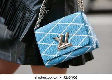 MILAN - SEPTEMBER 22: Woman with Louis Vuitton pale blue bag before Max Mara fashion show, Milan Fashion Week street style on September 22, 2016 in Milan.