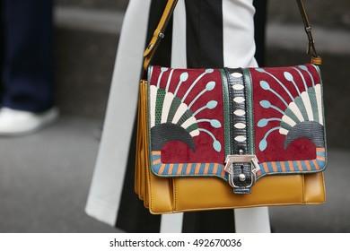 MILAN - SEPTEMBER 22: Woman with Paula Cademartori bag with colorful pattern before Max Mara fashion show, Milan Fashion Week street style on September 22, 2016 in Milan.