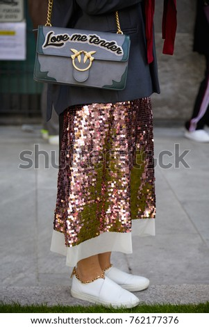 MILAN - SEPTEMBER 22  Woman with Pinko Love me tender bag and pink sequin  skirt da0965dfe49