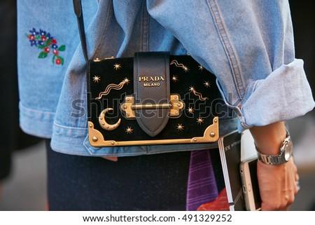 c29117a6b3 real milan september 22 woman with prada bag with moon and stars before  prada fashion 51042