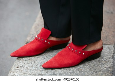 MILAN - SEPTEMBER 22: Woman with red pointed shoes before Max Mara fashion show, Milan Fashion Week street style on September 22, 2016 in Milan.