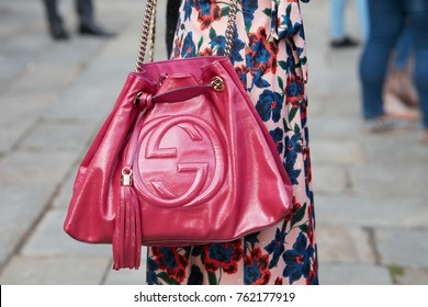 cfce706326d MILAN - SEPTEMBER 22  Woman with red cherry Gucci bag and floral design  dress before