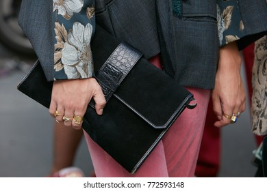 MILAN - SEPTEMBER 23: Man with black leather bag and pink trousers before Antonio Marras fashion show, Milan Fashion Week street style on September 23, 2017 in Milan.