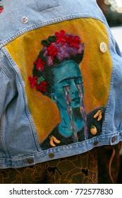 MILAN - SEPTEMBER 23: Woman with Frida Kahlo portrait on blue jeans jacket before Antonio Marras fashion show, Milan Fashion Week street style on September 23, 2017 in Milan.