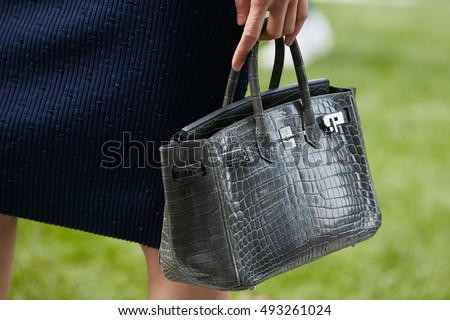 9f03baf3cb0 MILAN - SEPTEMBER 23  Woman with gray crocodile Hermes bag before Giorgio  Armani fashion show