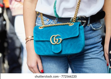 MILAN - SEPTEMBER 23: Woman with light blue velvet Gucci bag with golden chain and belt before Ermanno Scervino fashion show, Milan Fashion Week street style on September 23, 2017 in Milan.