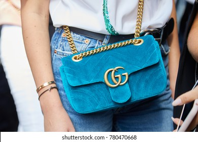 MILAN - SEPTEMBER 23: Woman with light blue velvet Gucci bag with golden chain before Ermanno Scervino fashion show, Milan Fashion Week street style on September 23, 2017 in Milan.