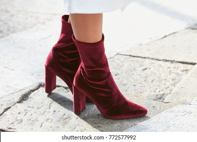 MILAN - SEPTEMBER 23: Woman with red velvet high heel boots before Antonio Marras fashion show, Milan Fashion Week street style on September 23, 2017 in Milan.