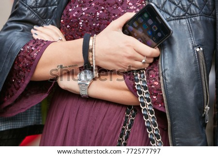 ff80cbc9482a37 MILAN - SEPTEMBER 23: Woman with Rolex Air King watch, Cartier bracelet  holding iPhone