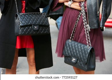 MILAN - SEPTEMBER 23: Women with black leather Chanel bags before Antonio Marras fashion show, Milan Fashion Week street style on September 23, 2017 in Milan.