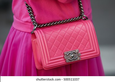 MILAN - SEPTEMBER 24: Woman with pink Chanel leather bag before Jil Sander fashion show, Milan Fashion Week street style on September 24, 2016 in Milan.
