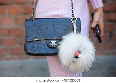 MILAN - SEPTEMBER 24: Woman poses for photographers before Fendi show with Chanel crocodile bag during Milan Fashion Week Day 2, Spring / Summer 2016 street style on September 24, 2015 in Milan.