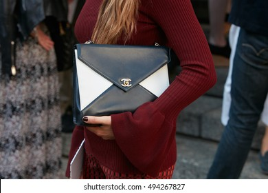 54a67a51c39d MILAN - SEPTEMBER 25  Woman with black and white Chanel bag before  Salvatore Ferragamo fashion