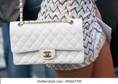 MILAN - SEPTEMBER 25: Woman with white leather Chanel bag before Salvatore Ferragamo fashion show, Milan Fashion Week street style on September 25, 2016 in Milan.