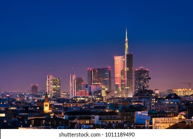 Milan skyline by night, new skyscrapers with colored lights. Italian landscape panorama.
