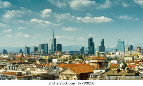 Milan skyline with modern skyscrapers in Porto Nuovo business district, Italy.  Aerial panoramic view of Milan on sunny day. Scenic panorama of Milan in summer. Milan buildings on background of Alps.