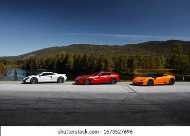 Miland, Norway. 04.06.2016: yellow Lamborghini Huracan, red Ferrari F12 and white Mclaren 650s
