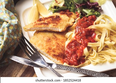 milanese escalope with pasta and tomato sauce