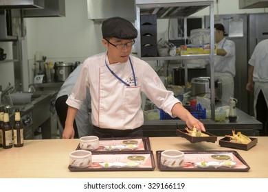 MILAN,I TALY-OCTOBER 07, 2015: preparing japanese food at the Japan's pavillion restaurant at EXPO2015, in Milan.