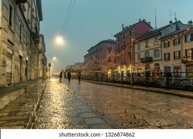 Milan/Italy - 12.20.2018:The street during the rain in Mialn with colorful lights.