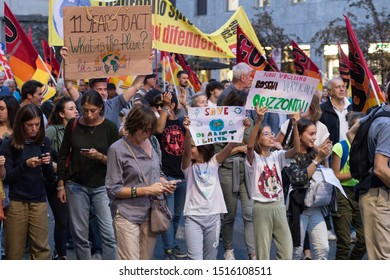 Milan,Italy - 27 September, 2019: Milano per il clima, Global strike for climate change. Thousands of people attend and fill the streets to voice their friday for future, with Greta Thunberg