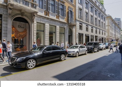 Milan,Italy - May 12 2018: Via Monte Napoleone upscale shopping street. Window shopping people outside Milano fashion district Dior & Burberry famous shops & high end exclusive boutiques.
