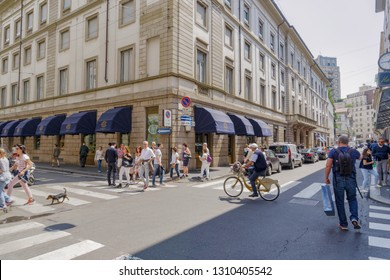 Milan,Italy - May 12 2018: Via Monte Napoleone upscale shopping street. People outside Milano fashion district historic pasticcerie Caffe Cova, founded in 1817.
