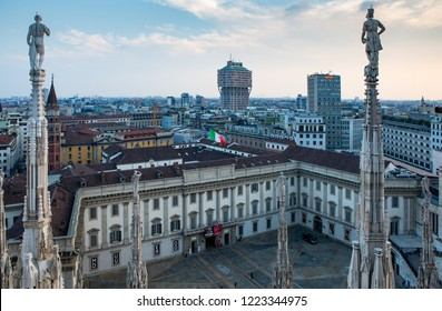 MILAN,ITALY-11 OCTOBER,2018: Beautiful view on center of Milano city from roof of Duomo cathedral church.National Italian green,white and red flag on pole