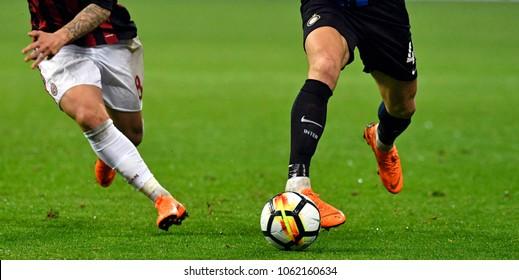 MILAN-ITALY-APRIL 04, 2018: soccer players close up legs in action during the italian league match AC Milan vs Inter Milan, at san siro stadium, in Milan.