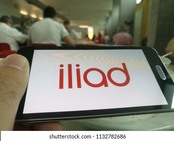 Milan,Italy-July 2018: Iliad 4G Operator Logo on a Smartphone in Man's Hand, New Telco Actor in Italy