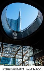 MILAN-ITALY-OCTOBER 12 2018:  Unicredit Bank skyscraper see through the wall hole of  piazza Gae Aulenti. Porta Garibaldi district,  Porta Nuova