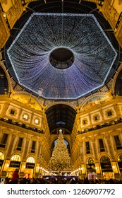 Milan,Lombardy,Italy- December 09 2018:This is the Galleria Vittorio Emanuele with Swarovski tree illuminated for the Christmas holidays and many people that is undergoing