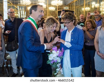 MILANO, AUGUST 5, 2016: mayor of Milan, Giuseppe Sala, celebrates in the wedding hall of Palazzo Reale the first civil union of a homosexual couple after the approbation of the  law by Parliament.