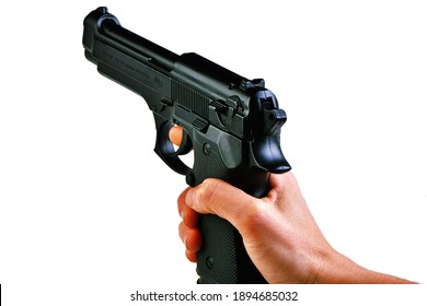 Milano, Italy - 01.03.2021: a plastic copy of a Beretta 92 pistol held by a woman's hand