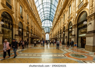 Milano, Italy, 04.10.2017: Must visit historical and touristic center of Milan: Galleria Vittorio Emanuele, shopping culture and historical bazaars