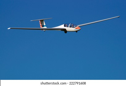 MILANO , ITALY - 1 JUNE 2014 : glider pilot during landing at an airport field on a clear sunny day
