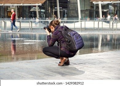 MILANO ITALY , 13 .MARCH 2019 : photografer make a photo of tourists in a new finantial district