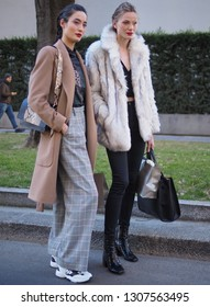 MILANO, Italy: 14 January 2019: Fashion bloggers street style outfits before ARMANI fashion show during Milano Fashion Week man Fall/winter 2019/2020