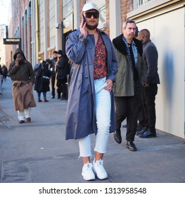 MILANO, Italy: 14 January 2019: Fashion blogger street style outfit before and after FENDI fashion show during Milano Fashion Week man Fall/winter 2019/2020