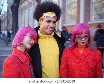 MILANO, Italy: 14 January 2019: Aya and Ami Amiaya and eccentric man street style outfit after FENDI fashion show during Milano Fashion Week man Fall/winter 2019/2020