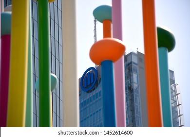 "Milano, Italy, 14.07.2019: ""Coloris"" installation by artist Pascale Marthine Tayou with the Arata Isozaki- Andrea Maffei Allianz Tower (Il Dritto/The Straight One) in the background"