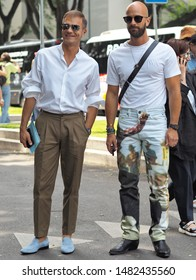 MILANO, Italy: 15 June 2019: Fashion bloggers street style outfits before Armani fashion show during Milano Fashion Week man 2019/2020