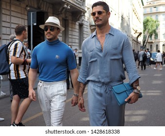 MILANO, Italy: 17 June 2019: Fashion bloggers street style outfits before Armani fashion show during Milano Fashion Week Man 2019/2020