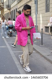 MILANO, Italy: 17 June 2019: Fashion blogger street style outfit before Armani fashion show during Milano Fashion Week Man 2019/2020