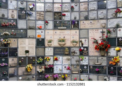 "Milano, Italy. 2018/2/8. A columbarium with cinerary urns (with human ashes) at the Cimitero Monumentale (""Monumental Cemetery"") in Milan, Italy."