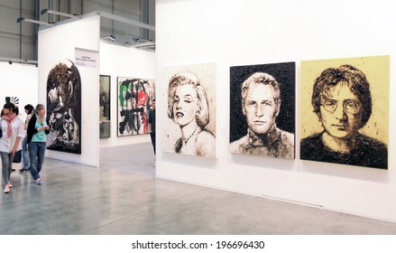 MILANO, ITALY - APRIL 08, 2011: People visit paintings galleries during MiArt, international exhibition of modern and contemporary art in Milano, Italy