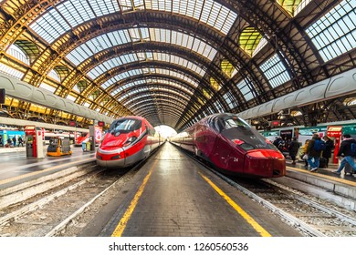 MILANO, ITALY - DECEMBER 12, 2018: TRENITALIA FRECCIAROSSA and NTV ITALO  trains waiting at Milano Centrale station