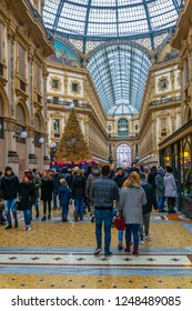 MILANO, ITALY, JANUARY 2, 2018:  People are pssing through Galleria Vittorio Emanuele II in Milan during christmas, Italy.